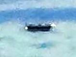 雲の上でUFOと遭遇!? 旅客機から撮影された謎の写真が大反響!=英