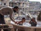 """【感動写真】「ガザ地区」紛争地帯で激写された""""子どもたちの微笑み"""" ― 破壊され尽くした街の中で命が輝く瞬間"""